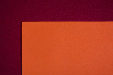 acetate: Eva foam ethylene vinyl acetate smooth orange surface on red sponge plush background