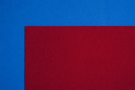 acetate: foam ethylene vinyl acetate red surface on blue sponge plush background