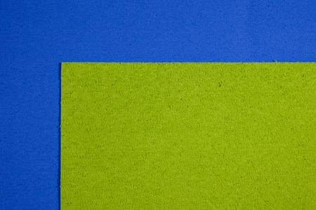 eva: Eva foam ethylene vinyl acetate apple green surface on blue sponge plush background Stock Photo