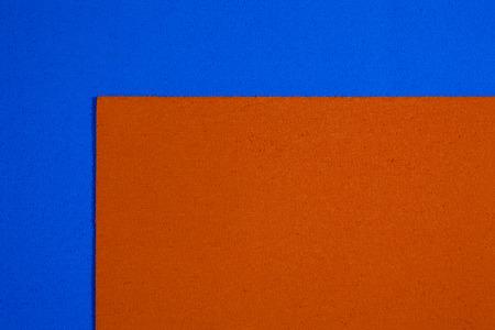 acetate: Eva foam ethylene vinyl acetate orange surface on blue sponge plush background Stock Photo