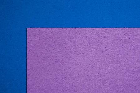 eva: Eva foam ethylene vinyl acetate bright purple surface on blue sponge plush background