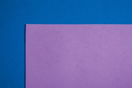 acetate: Eva foam ethylene vinyl acetate smooth bright purple surface on blue sponge plush background
