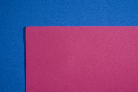 eva: Eva foam ethylene vinyl acetate smooth pink surface on blue sponge plush background
