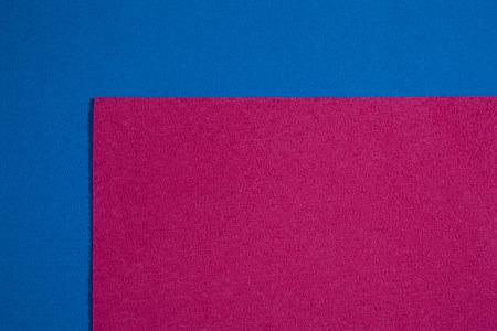 ethylene: Eva foam ethylene vinyl acetate pink surface on blue sponge plush background