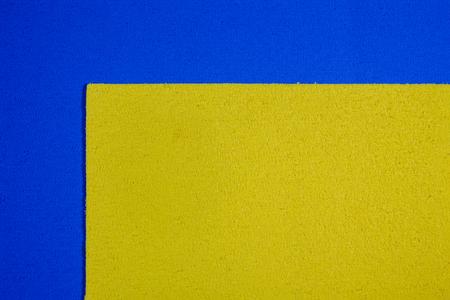 acetate: Eva foam ethylene vinyl acetate lemon yellow surface on blue sponge plush background
