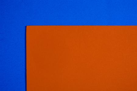 acetate: Eva foam ethylene vinyl acetate smooth orange surface on blue sponge plush background