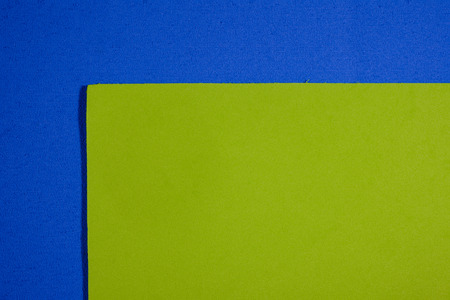 acetate: Eva foam ethylene vinyl acetate smooth apple green surface on blue sponge plush background Stock Photo