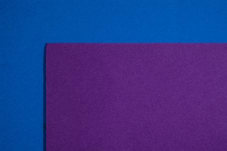 eva: Eva foam ethylene vinyl acetate smooth purple surface on blue sponge plush background Stock Photo