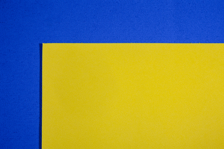 acetate: Eva foam ethylene vinyl acetate smooth lemon yellow surface on blue sponge plush background