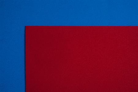 eva: Eva foam ethylene vinyl acetate smooth red surface on blue sponge plush background