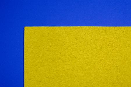 eva: Eva foam ethylene vinyl acetate sponge plush lemon yellow surface on blue smooth background