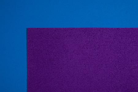ethylene: Eva foam ethylene vinyl acetate sponge plush purple surface on blue smooth background Stock Photo