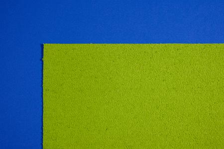 acetate: Eva foam ethylene vinyl acetate sponge plush apple green surface on blue smooth background Stock Photo