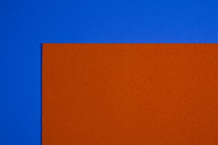 eva: Eva foam ethylene vinyl acetate sponge plush orange surface on blue smooth background
