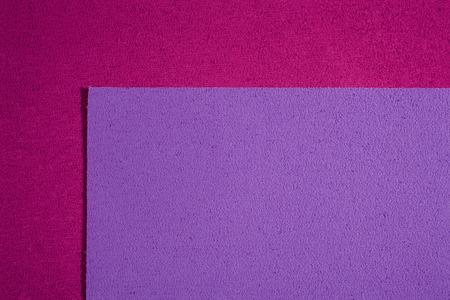 eva: Eva foam ethylene vinyl acetate light purple surface on pink sponge plush background Stock Photo