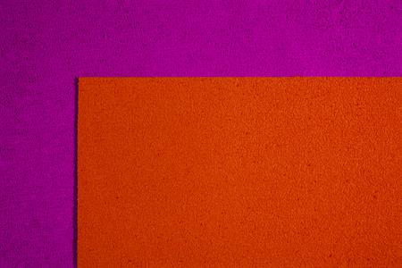 eva: Eva foam ethylene vinyl acetate orange surface on pink sponge plush background Stock Photo