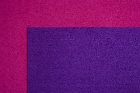 eva: Eva foam ethylene vinyl acetate purple surface on pink sponge plush background Stock Photo