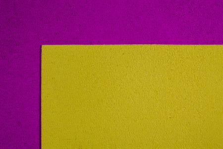 ethylene: Eva foam ethylene vinyl acetate lemon yellow surface on pink sponge plush background Stock Photo