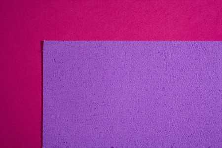 eva: Eva foam ethylene vinyl acetate sponge plush light purple surface on pink smooth background Stock Photo
