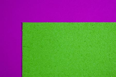 Eva foam ethylene vinyl acetate sponge plush apple green surface on pink smooth background Stock Photo