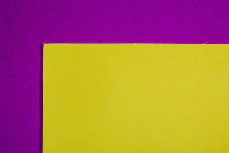 eva: Eva foam ethylene vinyl acetate smooth lemon yellow surface on pink sponge plush background