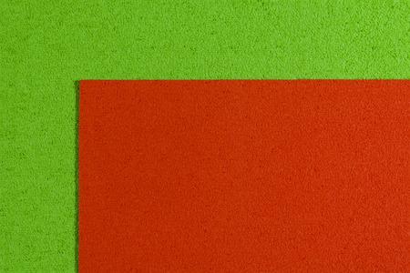 eva: Eva foam ethylene vinyl acetate orange surface on apple green sponge plush background