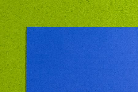 ethylene: Eva foam ethylene vinyl acetate blue surface on apple green sponge plush background Stock Photo