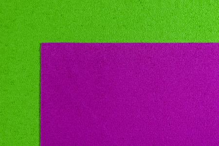 ethylene: Eva foam ethylene vinyl acetate pink surface on apple green sponge plush background Stock Photo