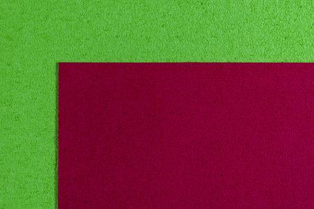 ethylene: Eva foam ethylene vinyl acetate red surface on apple green sponge plush background Stock Photo