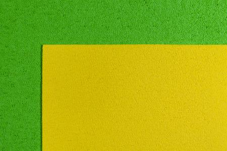 eva: Eva foam ethylene vinyl acetate lemon yellow surface on apple green sponge plush background