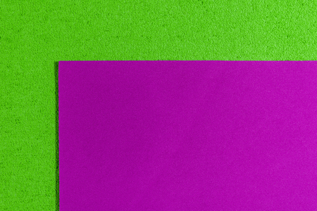 Eva foam ethylene vinyl acetate smooth pink surface on apple green sponge plush background Stock Photo