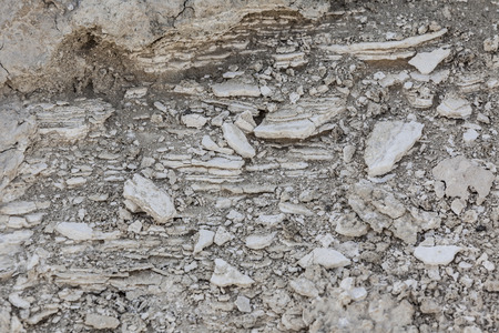 stratified: Shear of stratified limestone stone and arid terrain textured background