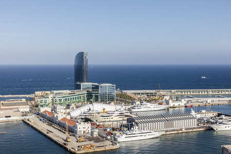 View from cable car from above on Barcelona sea port ships yachts works