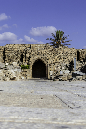 Crusaders gate entrance ancient wall ruins from inside of the Caesarea national park vertical