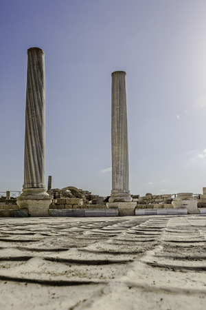 Doric white marble columns ruins from low angle with floor Caesarea national park Stock Photo