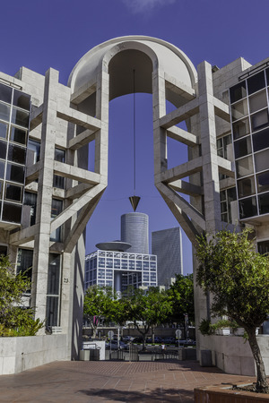 Azrieli buildings and haKirya through Tel Aviv performing arts center gate
