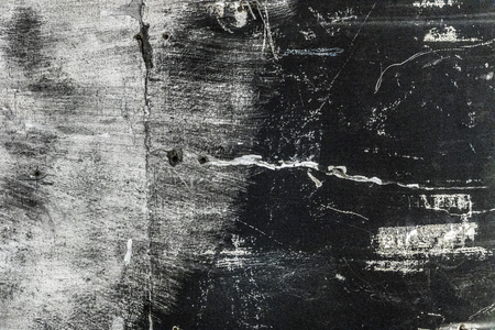 Rough black burned concrete wall background with whitewash scratches