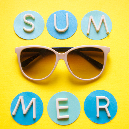 Sunglasses on yellow background and text summer. Top view. Holidays and vacation concept square photo for social media advertiesements