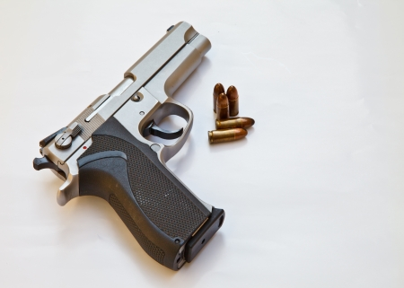 Semi-automatic pistol and bullets photo