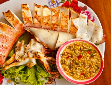 Grilled squid in meal time Thailand photo