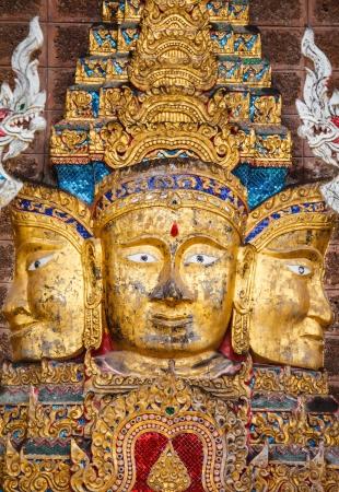 budha: budha on wall in temple Thailand