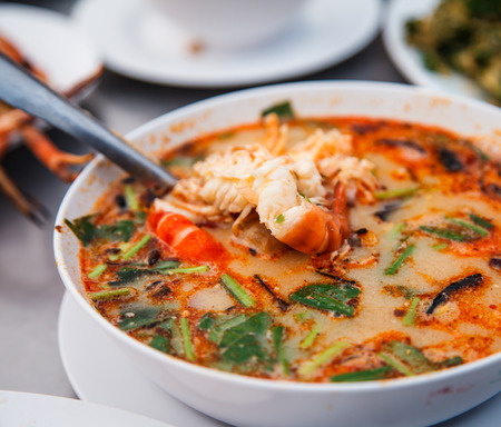 sour grass: prawn and lemon grass soup with mushrooms is thai menu in Thailand Stock Photo