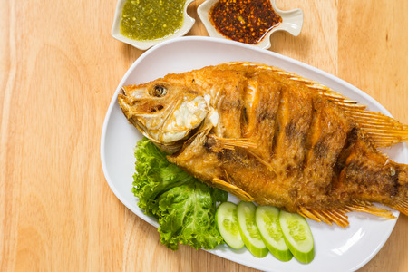 chilli sauce: fried fish with sour sauce and chilli sauce