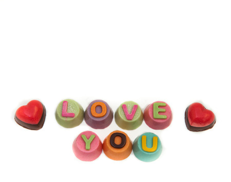 Letters chocolate love in Valentines Day on white background. Stock Photo