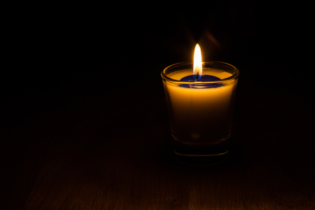 lighting a candle in my heart told me to light a candle. Stock Photo
