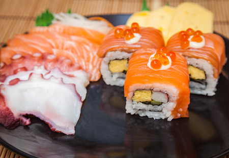 Japanese food consists of rice, salmon, eggplant. sushi for meal time. 版權商用圖片