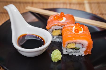 Japanese food consists of rice, salmon, eggplant.