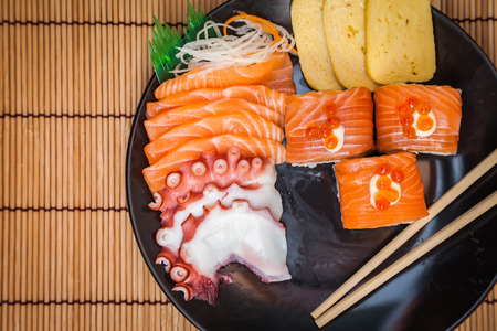 Japanese food consists of rice, salmon, eggplant, octopus. sushi for meal time.