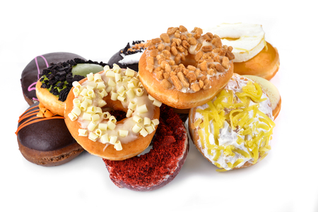 Colorful and tasty donuts on white background Stock Photo