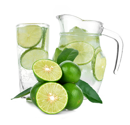 Full glass of fresh cool tonic with lime fruits isolated on white background Stock Photo